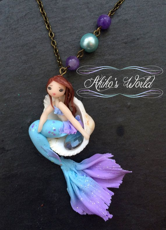 Tiny purple and blue mermaid in her seashell by AkikosWorld
