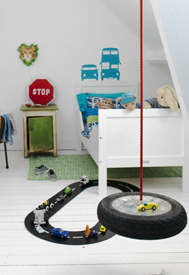 I thought Nathan would enjoy this race track on the floor under his bed, especially since his will be a mini loft.  The vinyl stickers are expensive, but I've seen some Hot Wheels tape somewhere... I'm sure there is an easy DIY for this when I get to that point.