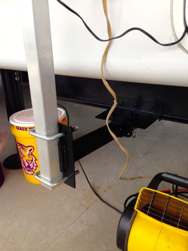 Receiver insert added to the side of the rv on the frame to hold a tv rack for tailgating and camping