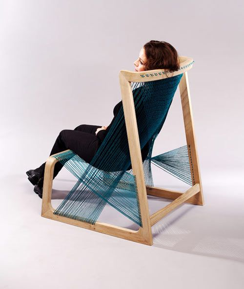 Silkchair by Alvi Design . It is made of FSC-certified oak with a back and seat created using silk thread strung through the frame.