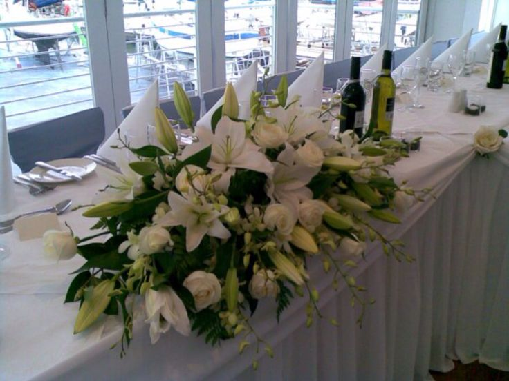 Bridal table centrepiece at #pelicanslanding by www.newminsterfunctiondesign.com