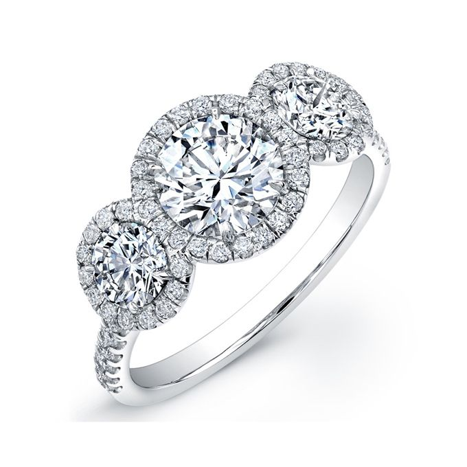 Brides.com: Three-Stone Engagement Rings. The Center of My Universe three-stone diamond ring set in 18k white gold, price upon request, Rahaminov for Forevermark See more round-cut rings.