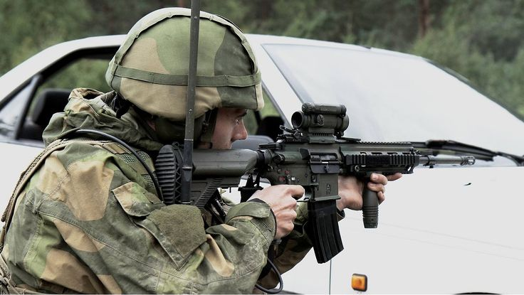 A soldier with the Norwegian Home Guard taking aim with his HK416N during the large scale exercise 'Djerv'. Eastern Norway, 5 September, 2014.