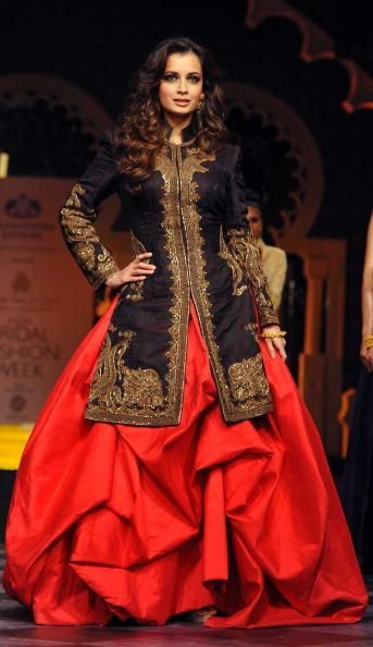 Dia Mirza showcases a creation by designer Raghavendra Rathore during the Aamby Valley India Bridal Fashion Week.
