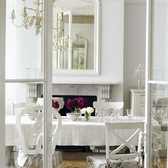 White Chairs With Faded Fabric Seat Covers None Of It Matching Lend An Air Shabby Chateau Chic To This French Style Dining Room