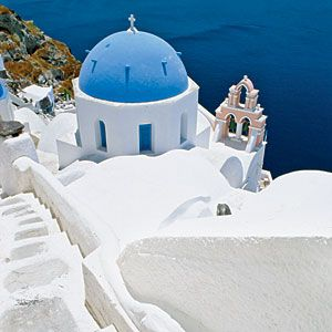 The magical Greek Island of Santaorini; just sit there....read books, lay in the sun....by MYSELF....would love it! After that: back home to be there for my love and kids. (I need some quiet time now and than)