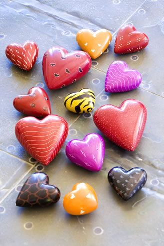 handpainted rock hearts - I actually made hearts from flour dough years ago and hand painted them and turned them into refrigerator magnets. I just recently dropped and broke the last one. Time to make more. They're so awesome.