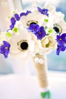 white anemones and blue (not purple) forget me nots will be my bouquet. Add some spring greens, maybe baby's breath