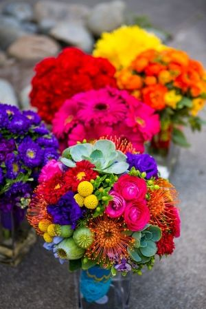 #whimsical wedding #colorful bouquet Bride has multicolored bouquet and bridesmaids each have own color.