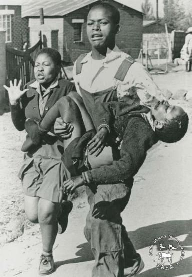 June 16, 1976. 13 year old Hector Pieterson shot dead by apartheid police is carried by another student, with his sister running along side.
