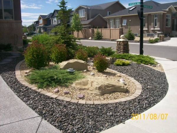 Driveway landscaping for a corner lot done with for Landscape garden maintenance