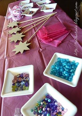 A very fairy activity - decorate wands with beads, gem-stones, glitter paint, stamps. Tie a ribbon with a name tag and leave to dry for taking home.
