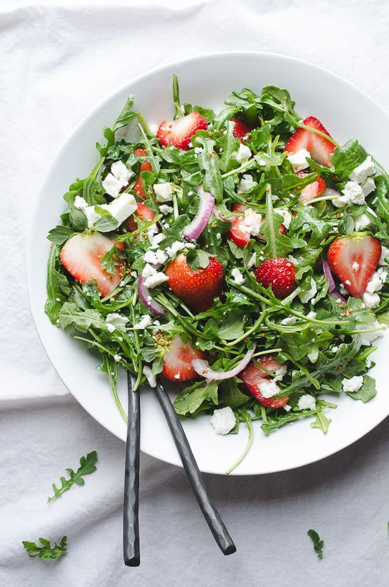 Baby Arugula and Strawberry Salad with Feta-this beautiful salad covers the spectrum of flavors and is a perfect pot luck favorite! *Vegan options From Caroline at Taste Love and Nourish