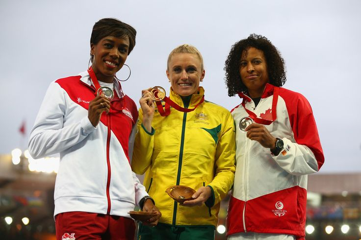 (L-R) Silver medalist Tiffany Porter of England, gold medalist Sally Pearson of Australia and bronze medalist Angela Whyte of Canada