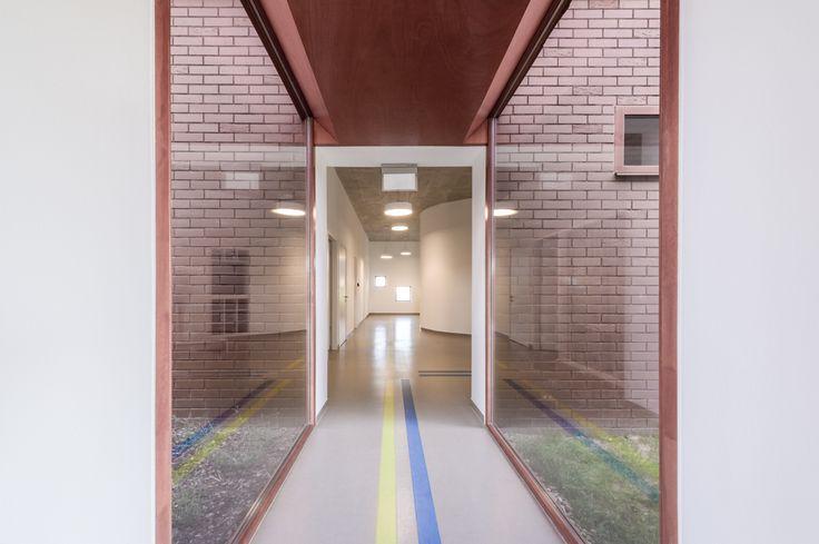 """Daycare in Nagykovácsi by Földes Architects """"The volumes are interconnected via short glazed passageways.""""  """"Az egymás mellé tett különböző épület tömegeket üvegezett közlekedőkkel kötöttük össze.""""   #foldesarchitects #daycare #nursery #hungary #architecture #interior #brick #nagykovacsi #bölcsöde #óvoda #építészet #belső #üveg #tégla"""