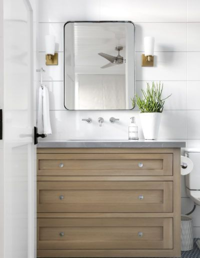 Wooden Single Vanity + White Shiplap Walls in this Half Bath   Lindye Galloway Interiors