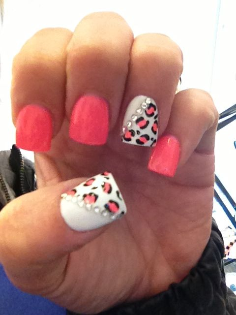 Cute nails. Salmon colored nail polish, white nail polish, rhinestones, and leopard print.