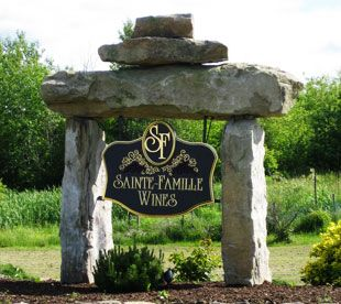 """Sainte Famille Wines Ltd. is a small family owned vineyard and winery located on an original Acadian Village site known as """"La Paroisse Sainte-Famille De Pisiquit"""" settled around 1685. Situated on a gently sloping hill, overlooking the Avon River Valley, Sainte- Famille Wines has one of the warmest vineyard sites read more"""