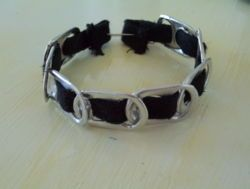 Pop top bracelet.  Would be cute with zebra print ribbon.
