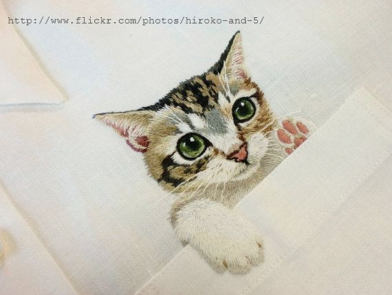 a handembroidered cat in the pocket on the white by ShopGoGo5