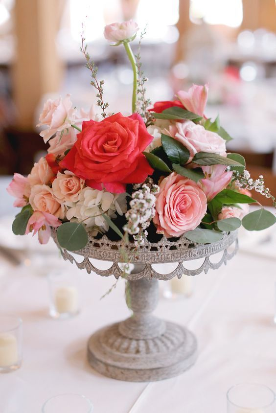 whimsical pink floral wedding centerpiece via photography by gem / http://www.deerpearlflowers.com/unique-wedding-centerpiece-ideas/6/