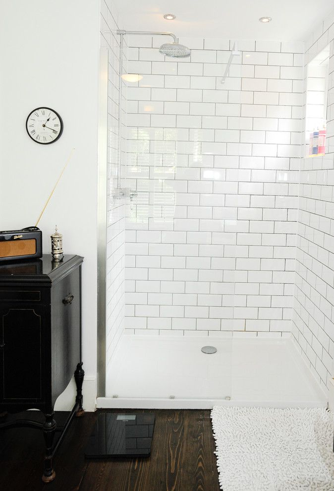 Magnificent kohler shower base in Bathroom Contemporary with Frameless Shower Door next to White Subway Tile Grey Grout alongside Tile And Wood Flooring and Ceramic Tile Walk In Showers