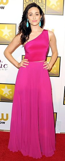 Emmy Rossum made a statement in a bright fuchsia Monique Lhuillier dress at the Critics' Choice TV Awards. Her earrings amp up the fun, colorful look!
