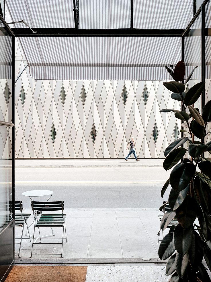 A simple view from the entrance of the cafe looking over to the contrasting textures of the delightful ethnography museum (MEG). Cafe Paradiso Geneva.