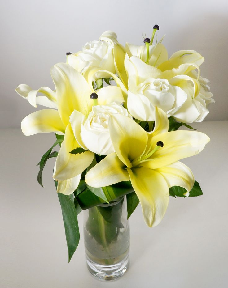 Helene - A simple and fragrant bouquet arrange with pure milky white lilies. A subtle present that surely bring a smile on anyone's face, perfect for every occasion. Vase Not Included - See more at: http://www.timesflora.com/Helene