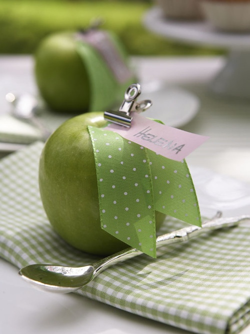 A sweet idea using an Apple clipped with a pretty ribbon for place setting.