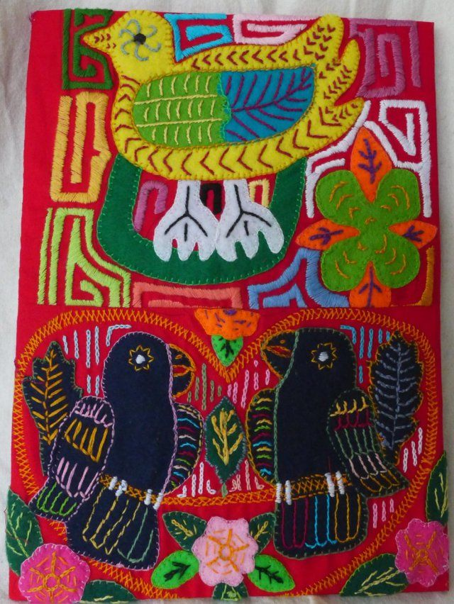 This lovely appliqué and embroidery panel, showing two black parrots and one yellow duck on a red background was created to exhibit with the Colombian Gold exhibition 2013 at the British Museum and displayed in the Great Court while it was on.