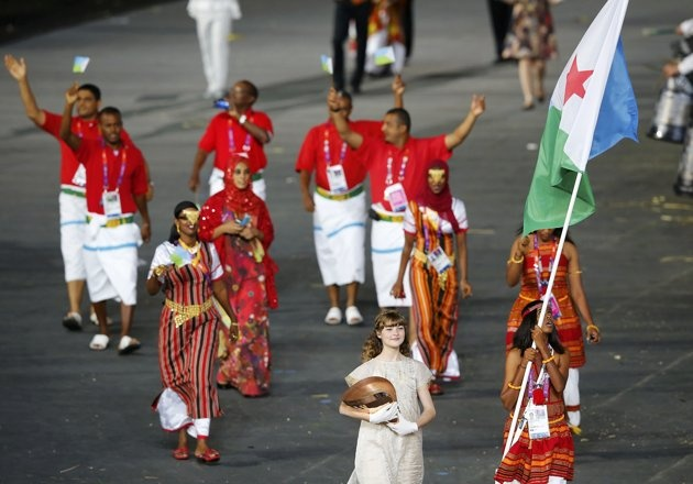 Djibouti's flag bearer Zourah Ali holds the national flag as she leads the contingent in the athletes parade during the opening ceremony of the London 2012 Olympic Games at the Olympic Stadium July 27, 2012.