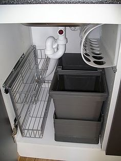 Not sure about the black pieces but I really like the pull out unit. -a // orig: ikea Rationell under the sink solution! @ MyHomeLookBookMyHomeLookBook