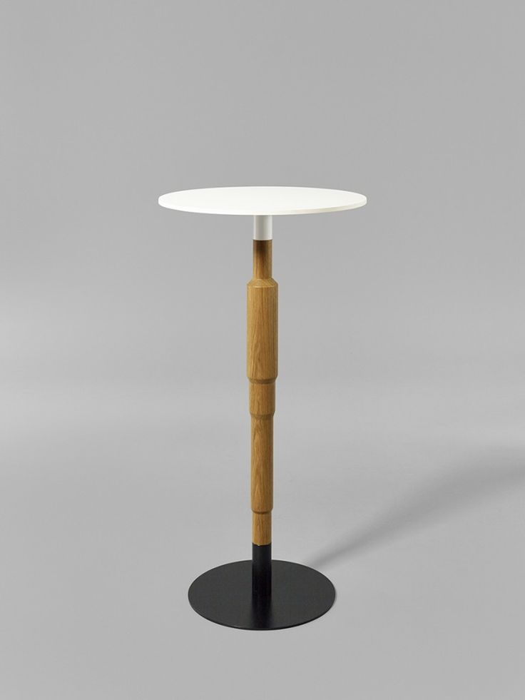 Minus tio - Cosmos 1100mm wood pedestal table in clear lacquered oak with 580mm diameter table top and black base