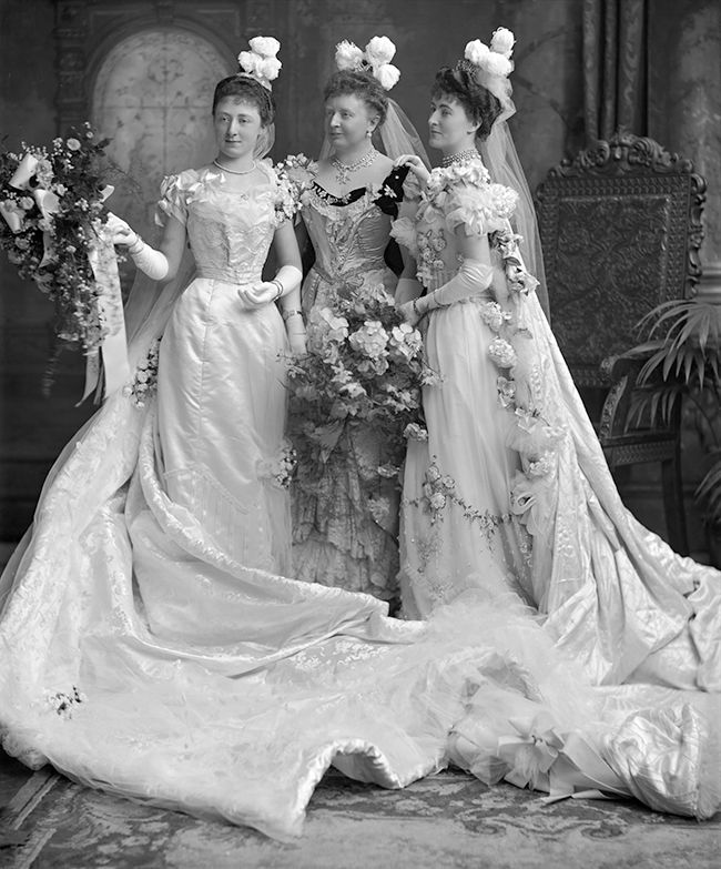 Lady Darell, with her daughter Dorothy and Mrs. H.C. Jobson, London, 1900. They are dressed in court attire, ready to be presented.