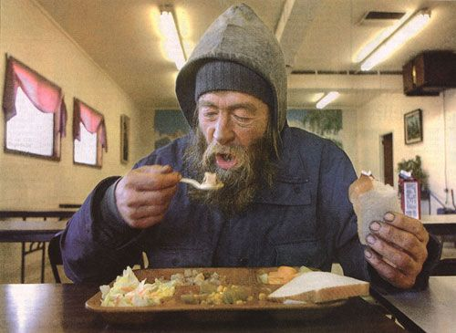 Feeding homeless people.   poor+man+eating+in+soup+kitchen.jpg (500×365)