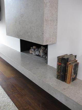 Concrete fireplace Sigmar Design. Visit NuConcrete.com for all Concrete_Design & Installation.