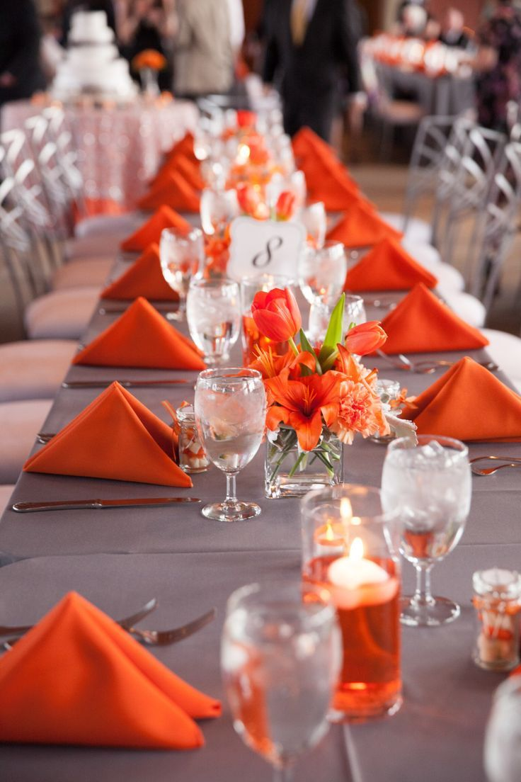 Gray and orange wedding. Simple centerpieces for long feasting tables.                                                                                                                                                     More