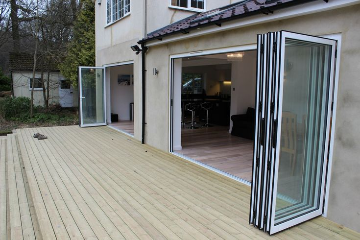 2 x Sets of bi-fold doors onto decked area with skylights and vaulted ceiling.
