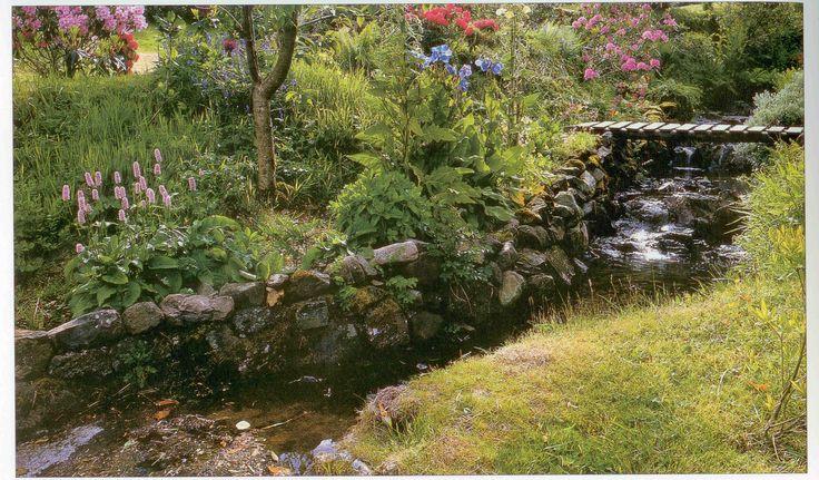 Bridge pond in a rustic garden.  www.outdoorcreations.com.au