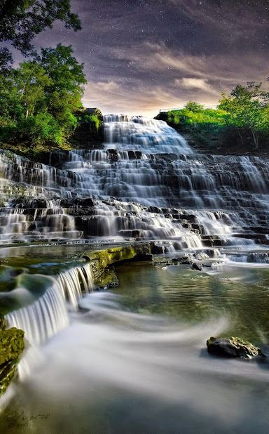 """GAlbion Falls, Hamilton, Ontario, Canada!  Albion Falls is a 19 m (62 ft) classical/cascade waterfall flowing down the Niagara Escarpment in Red Hill Valley, in Hamilton, Ontario, Canada. With cascade falls the downpour is staggered into a series of steps causing water to """"cascade"""". The top of the falls are located on Mud Street. The lower-end of the falls can be found at the south-end of King's Forest Park in lower Hamilton by following the Red Hill Creek south towards the Niagara…"""