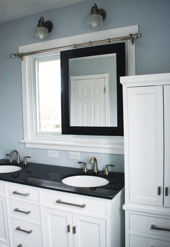 Photos Of Bathroom Remodel sliding mirror tall linen cabinet by Since I Became a Mom