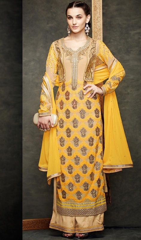 Get an outstanding look dressed in this yellow and beige color georgette net embroidered palazzo suit. The patch, resham, lace and stones work on dress personifies the whole appearance. #geogerettepalazzodress #anklelengthpalazzosuits #pakistanidesigndresses