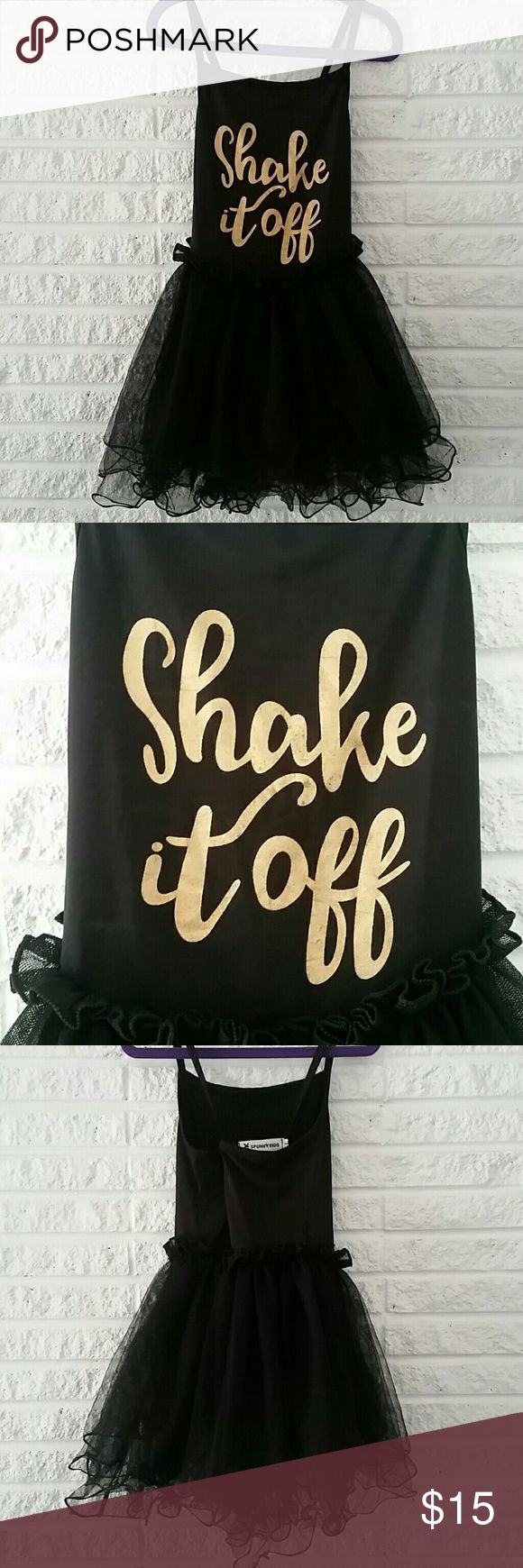 Girls black dance leotard with Gold Script Such an adorable dance leotard, the skirt has many layers of tool material with the traditional black leotard attached underneath. It crosses in the back and is made of stretchy spandex material. 5k Spunky Kids Costumes Dance