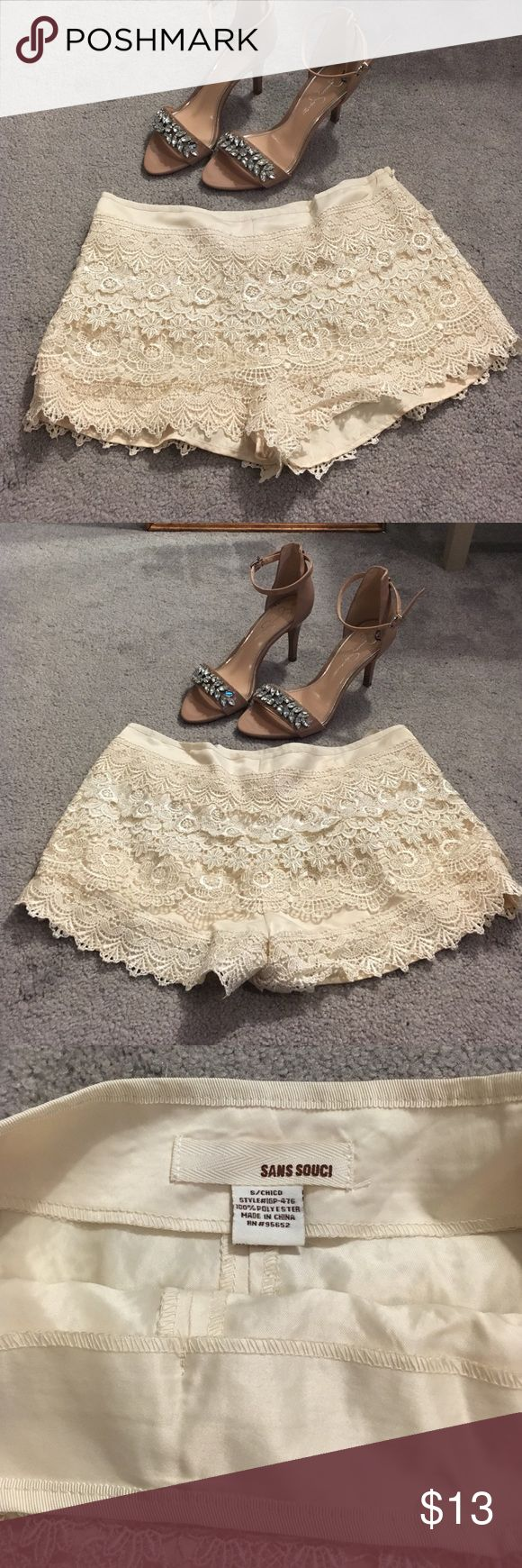 Cream lace shorts High waisted lace shorts in cream colored. Wit zipper on the left hip. Worn once. Sans Souci Shorts