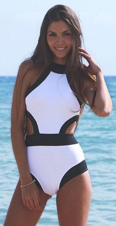 Look your best this season with a white one piece swimsuit! It has a paneled black edge in contrast black, cutout accent. Details: - Contrast black and white - Cutaway neckline - Cutout design - Fashi
