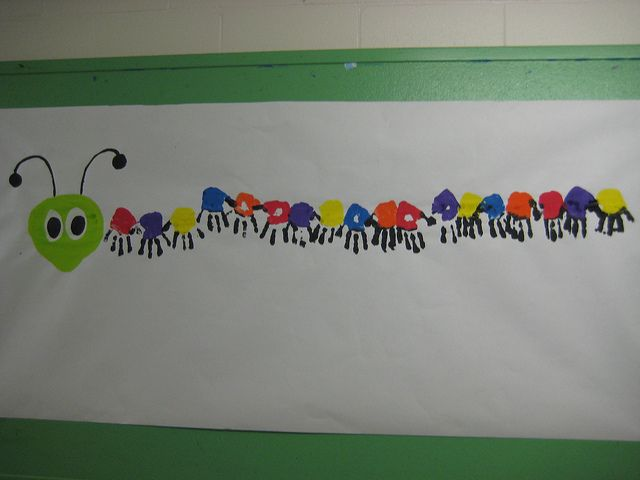 Class handprint caterpillar bulletin board... gotta come up with a catchy saying and maybe have students write something under it ~ Hungry Caterpillar