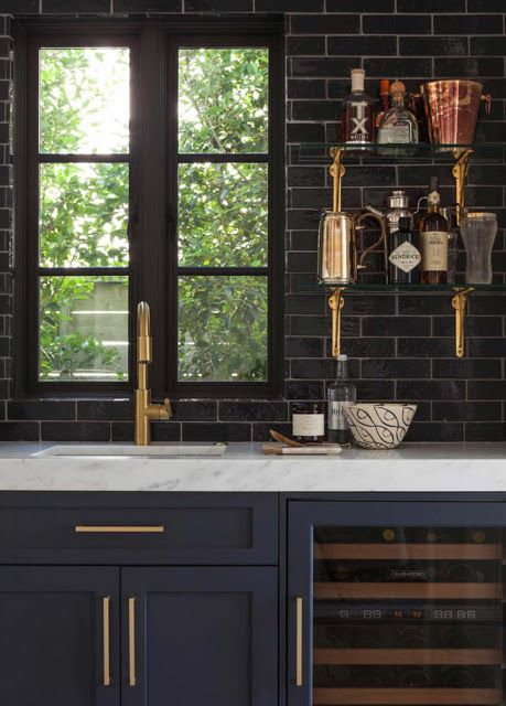 Love the gold, the black tile, and blue cabinets. Gorgeous combo!