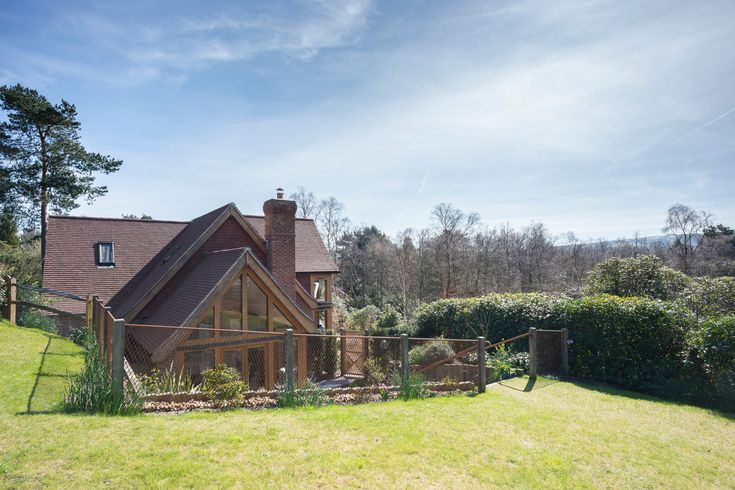 New Build Family Home, Storrington  http://www.jolliffdevelopments.com/past-work-gallery/25y4zsab8njahha7a8asmga8y68ktm View of sunken Glulam timber framed garden room with far reaching views of the South Downs National Park.
