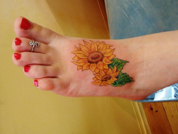 Sunflower by vanzanto - Sunflower tattoo on the foot by Vanzanto. A beautiful set of sunflowers inked on the foot. You can see a big and a smaller sunflower on the design implying it's a fully grown and young sunflower.